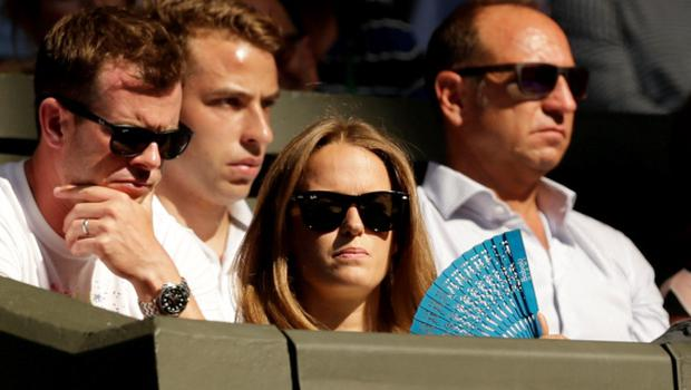 Kim Murray uses a fan as she watches husband, Andy Murray of Britain play his match against Mikhail Kukushkin of Kazakhstan at the Wimbledon Tennis Championships in London, June 30, 2015.   REUTERS/Henry Browne