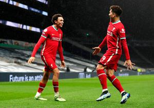 Liverpool's Trent Alexander-Arnold (left) and Roberto Firmino both scored in the win over Spurs. Catherine Ivill/PA Wire.