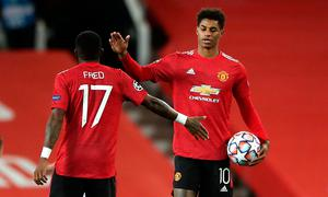 Manchester United's Marcus Rashford with the match ball and Fred after the Champions League Group H win over RB Leipzig at Old Trafford, Manchester.