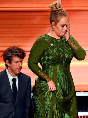Producer Greg Kurstin (L) and recording artist Adele accept the Album Of The Year award for '25' onstage during The 59th GRAMMY Awards at STAPLES Center on February 12, 2017 in Los Angeles, California.  (Photo by Kevin Winter/Getty Images for NARAS)