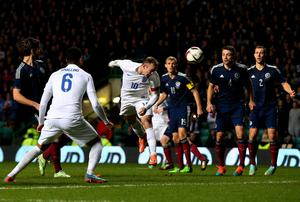 Wayne Rooney scores England's second goal in their friendly against Scotland at Celtic Park. Photo: Alex Livesey/Getty Images