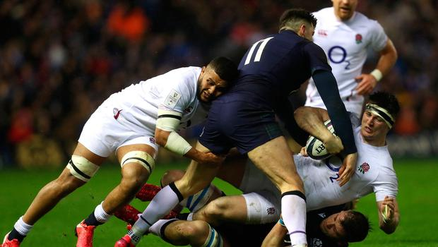 Scotland's Blair Kinghorn and Magnus Bradbury tackle England's Tom Curry during the Six Nations match at BT Murrayfield Stadium, Edinburgh. Photo credit: David Davies/PA Wire