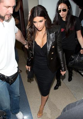 While we LOVE her leather jacket, it's not exactly comfortable travelwear as she makes her way through LAX Airport