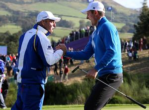 Europe's Justin Rose celebrates with captain Paul McGinley after his foursomes match during day one of the 40th Ryder Cup at Gleneagles Golf Course, Perthshire