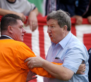 Byrne is held back by a steward as he argues with a ref in 2004. Photo: Brian Lawless / SPORTSFILE