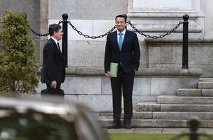 Minister for Finance Paschal Donohoe talking to Taoiseach Leo Varadkar after he address the nation on Covid-19 restrictions at Government Buildings. Picture: David Conachy