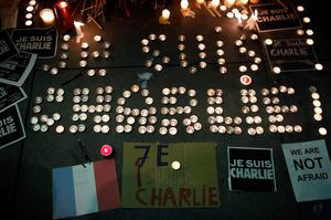 A makeshift memorial is seen outside the Consulate General of France during a vigil for the victims of an attack on satirical magazine Charlie Hebdo in Paris, in San Francisco, California January 7, 2015. REUTERS/Stephen Lam