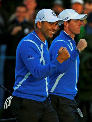 European Ryder Cup players Rory McIlroy (R) and Sergio Garcia celebrate winning the hole on the 17th green during their foursomes 40th Ryder Cup match at Gleneagles in Scotland   (REUTERS/Eddie Keogh)