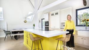 Entrepreneur Christine Murphy in her controversial kitchen. The kitchen was made by P&M Kitchens in Ferns, Co Wexford and the units are a combination of different materials and different colours including white, yellow, grey blue and plain oak. The architect, Eddie Phelan, ensured lots of light by adding windows and skylights where possible. The glass door opens on to the deck. Photo: Tony Gavin