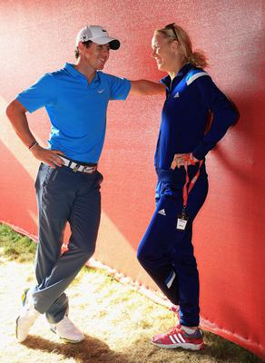 Rory McIlroy of Northern Ireland talks to his fiance Caroline Wozniacki of Denmark, after coming joint second after the final round of the Abu Dhabi HSBC Golf Championship at Abu Dhabi Golf Club on January 19, 2014 in Abu Dhabi, United Arab Emirates.  (Photo by Matthew Lewis/Getty Images)
