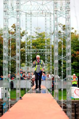 Professor Trevor Whittaker crosses a Guinness world record beating Meccano Bridge, spanning more than 100 feet across Clarendon dock in Belfast. Photo: Niall Carson/PA Wire