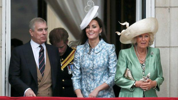 Britain's (L-R) Prince Andrew, Prince Harry, Catherine, the Duchess of Cambridge, Prince Harry and Camilla the Duchess of  Cornwall stand on the balcony at Buckingham Palace after attending the Trooping the Colour ceremony