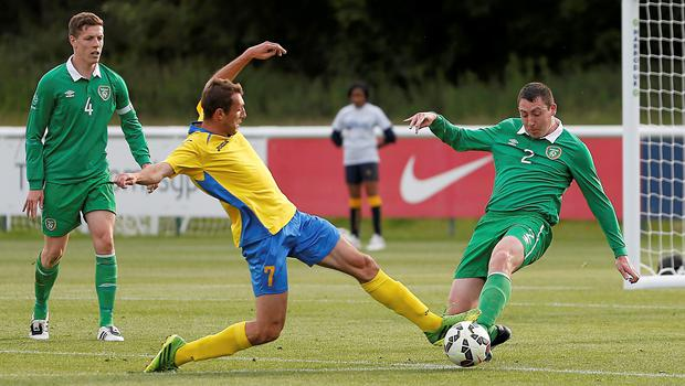 Joe Markey commits to a tackle against Ukraine's Vitalli Romanchuk