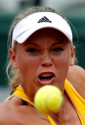 Caroline Wozniacki of Denmark eyes the ball as she prepares to play a shot to Karin Knapp of Italy during their women's singles match at the French Open tennis tournament at the Roland Garros stadium in Paris (REUTERS/Gonzalo Fuentes)