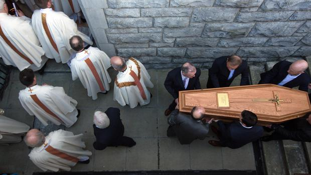 The coffin of Bishop Eamonn Casey is taken to the crypt by members of his family at the Cathedral of Our Lady Assumed into Heaven and St. Nicholas in Galway during his funeral. Photo: Tony Gavin