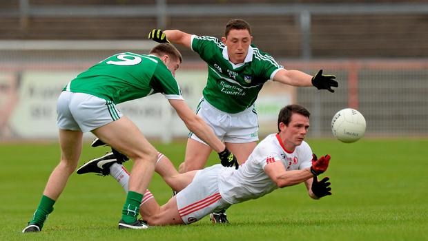 28 June 2015; Aidan McCrory, Tyrone, in action against Brian Fanning and Peter Nash, Limerick. GAA Football All-Ireland Senior Championship, Round 1B, Tyrone v Limerick. Healy Park, Omagh, Co. Tyrone. Picture credit: Oliver McVeigh / SPORTSFILE