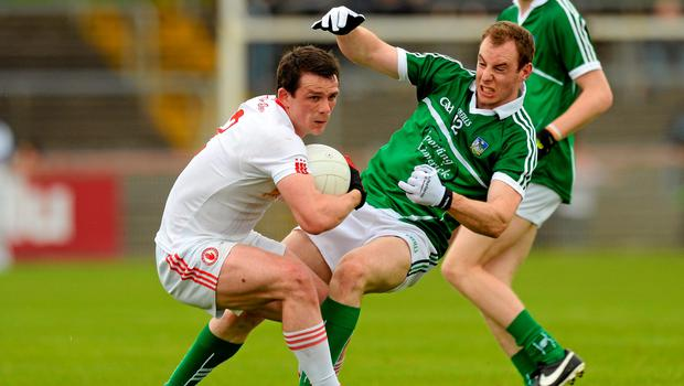 28 June 2015; Aidan McCrory, Tyrone, in action against Sean Buckley, Limerick. GAA Football All-Ireland Senior Championship, Round 1B, Tyrone v Limerick. Healy Park, Omagh, Co. Tyrone. Picture credit: Oliver McVeigh / SPORTSFILE