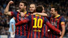 Barcelona players celebrate Lionel Messi's penalty against Manchester City