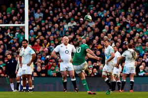 Ireland's fly half Johnny Sexton kicks a penalty during the Six Nations international rugby union match between Ireland and England at Aviva Stadium in Dublin, Ireland on March 1, 2015. Ireland won the game 19 - 9. AFP PHOTO / PAUL ELLISPAUL ELLIS/AFP/Getty Images