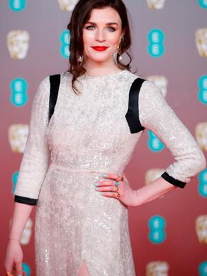 Irish actress Aisling Bea poses on the red carpet upon arrival at the BAFTA British Academy Film Awards at the Royal Albert Hall in London on February 2, 2020. (Photo by Tolga AKMEN / AFP)