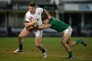 Harry Sloan of England tackled by Adam Byrne of Ireland