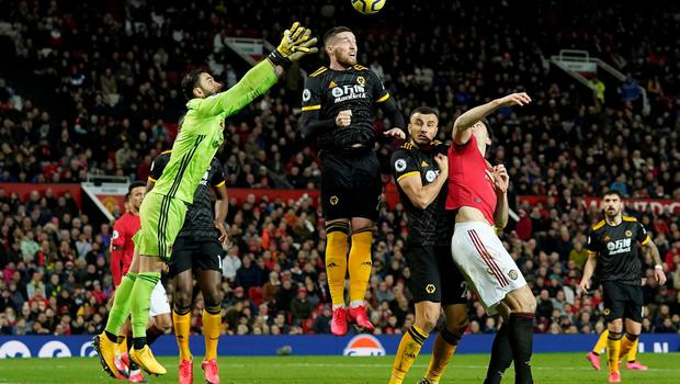 Wolverhampton Wanderers' Matt Doherty, Rui Patricio and Romain Saiss in action with Manchester United's Harry Maguire. Photo: Andrew Yates/Reuters