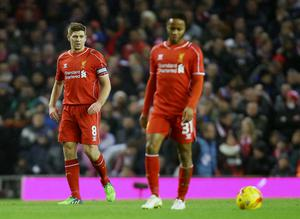 Liverpool's Steven Gerrard (left) and Raheem Sterling (right) look dejected after their team go a goal down during the Capital One Cup Semi Final against Chelsea