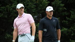 Rory McIlroy and Brooks Koepka. (Photo by Streeter Lecka/Getty Images)