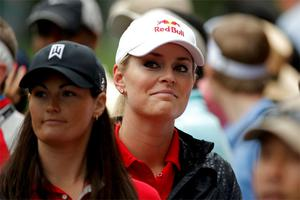 Skier Lindsey Vonn (R), girlfriend of Tiger Woods, walks with her physical therapist Lindsay Winninger (L) as they follow him during final round play