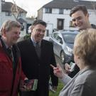 'Hold on there': Fianna Fáil's Paul McAuliffe and his team speaking with Una Cray while canvassing in Finglas, Dublin, this week. Photo: Arthur Carron.