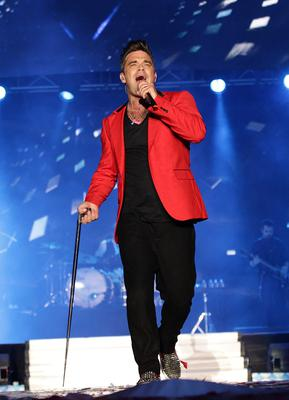 Robbie Williams onstage at the Capital FM Summertime Ball at Wembley in London in June 2013. Yui Mok/PA Wire