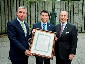 Ian Hyland, Business and Finance Media Group, and US Ambassador Kevin O'Malley present Congressman Brendan Boyle with a Certificate of Irish Heritage