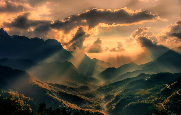 HEALED BY THE PASSAGE OF TIME: The sun's rays shine on the once-troubled Vietnamese mountains. Photo: Gerry Andrews