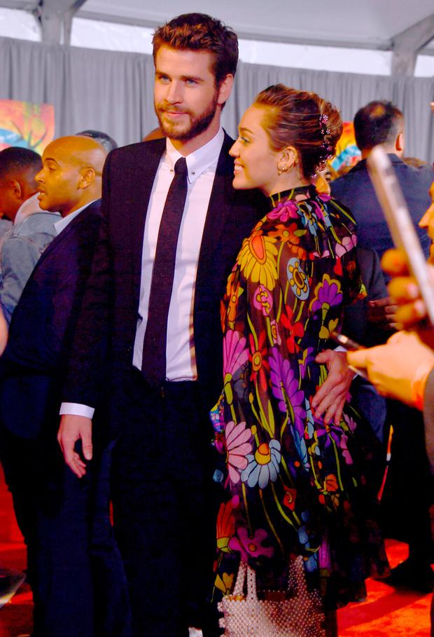 Liam Hemsworth and Miley Cyrus attend the Premiere Of Disney And Marvel's