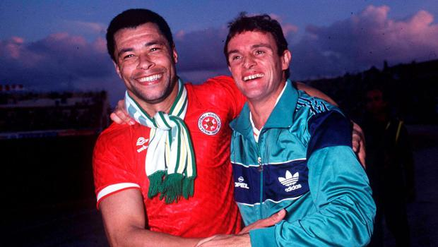 15 November 1989; Paul McGrath and Kevin Moran, Republic of Ireland, celebrate qualification for the 1990 World Cup Finals after defeating Malta in Malta. Soccer. Picture credit; Ray McManus/SPORTSFILE