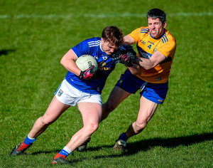 Oisin Pierson of Cavan in action against Jack Browne of Clare. Photo by Philip Fitzpatrick/Sportsfile