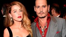 """Actors Amber Heard (L) and Johnny Depp attend the """"Black Mass"""" premiere during the 2015 Toronto International Film Festival at The Elgin on September 14, 2015 in Toronto, Canada.  (Photo by Jason Merritt/Getty Images)"""