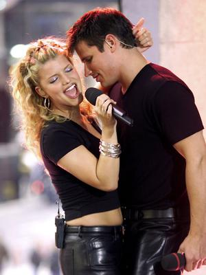 Jessica Simpson and Nick Lachey of 98 Degrees performing their hit song 'Where You Are' during TRL at the MTV studios in New York.   (Photo by Scott Gries/ImageDirect)