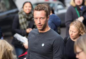 Coldplay lead singer Chris Martin arrives for the recording of the Band Aid 30 charity single in west London November 15, 2014. Singers came together to record a new version of the Band Aid charity song to raise money to combat Ebola in Africa.