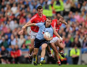 Dublin's Tomás Quinn in action against Cork's Fiachra Lynch, left, and Paudie Kissane during the Allianz Football League Division 1 final back in April 2011