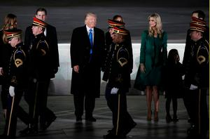 """U.S. President-elect Donald Trump stands with with his wife Melania, daughter Ivanka (2nd R) and son Eric (2nd L), as members of the  U.S. Army Band pass by at the """"Make America Great Again! Welcome Celebration"""" at the Lincoln Memorial in Washington, U.S., January 19, 2017.  REUTERS/Mike Segar"""