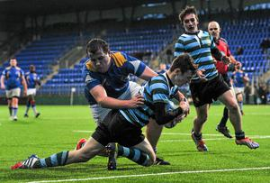Ben Kealy, St Gerard's School, scores a try despite the efforts of Ross Curran, Wilson's Hospital.