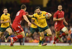 Australia winger Adam Ashley-Cooper Wales tries to hold off a challenge from Wales's George North during their clash at the Millennium Stadium. Photo: Stu Forster/Getty Images