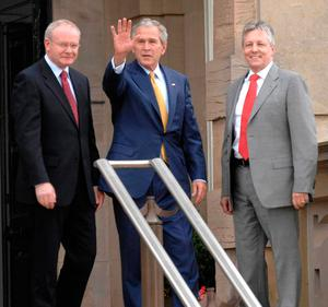 Deputy First Minister Martin McGuinness (left) and First Minister Peter Robinson (right) greeting US President George Bush at Stormont Castle in Belfast. Photo: Stephen Wilson/PA Wire