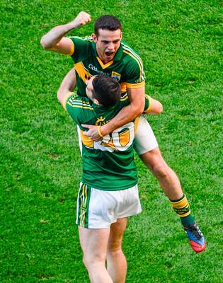 Another one gone: Kerry's Shane Enright celebrates Kerry's victory over Donegal in the 2014 All-Ireland final with team-mate Bryan Sheehan. Photo: Dáire Brennan/Sportsfile