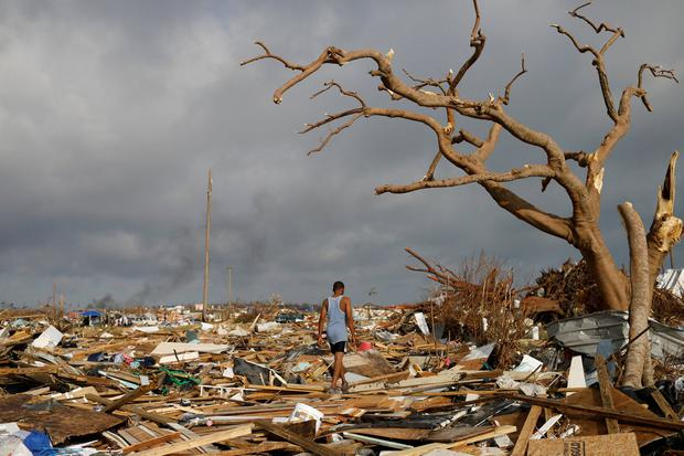 A man walks through debris after Hurricane Dorian hit the Abaco Islands in the Bahamas. PHOTO: REUTERS