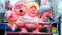 Effigies of Prime Minister Theresa May, former foreign secretary Boris Johnson, current Environment Secretary Michael Gove and former Brexit secretary David Davis, are driven past the Houses of Parliament, London, ahead of the House of Commons vote on the Prime Minister's Brexit deal. Yui Mok/PA Wire