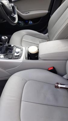A pint of Guinness sitting in his car ready to be delivered.