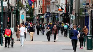 Moving on: People on Dublin's Grafton Street yesterday afternoon as Ireland moves through the phases easing restrictions put in place as a result of the coronavirus pandemic. Photo: Brian Lawless