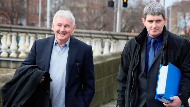 John Gilligan pictured with his son Darren, outside the Four Courts. Pic Frank Mc Grath